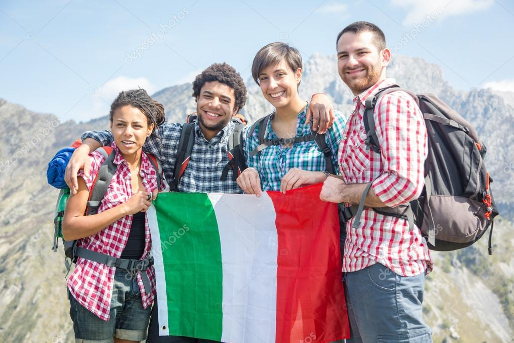 People with italian flag on top of mountain stock photo for Italian people