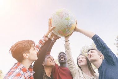Group of Teenagers Holding World Globe Map stock vector