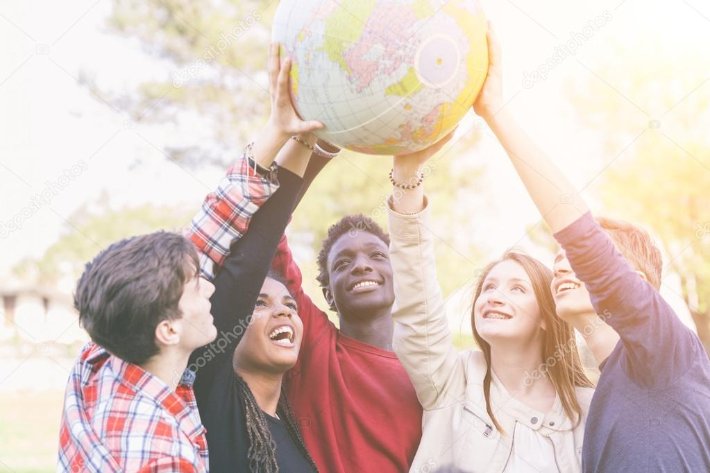 Group of Teenagers Holding World Globe Map