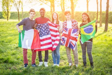 Teenage Friends Holding Flags from different Countries