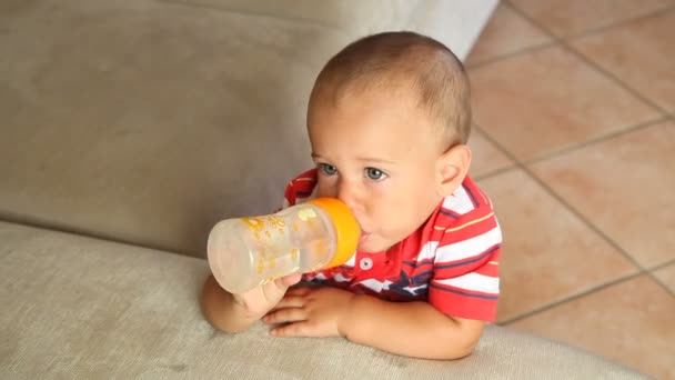 Little Child Drinking Water from Babys Bottle