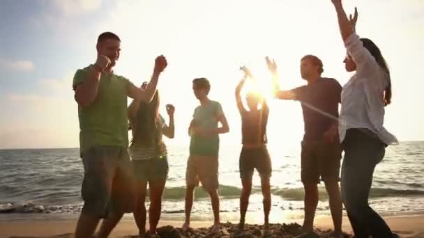 Friends Dancing at Beach