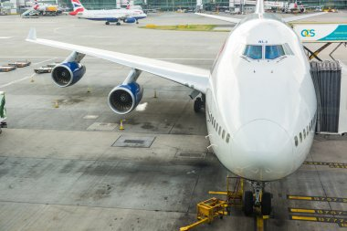LONDON, UNITED KINGDOM - AUGUST 19, 2014: British Airways Boeing 747 at London Heathrow airport with some more aircrafts on background