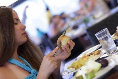 Girl cutting bun