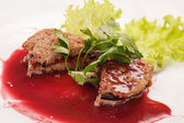 Steak with cranberry sauce