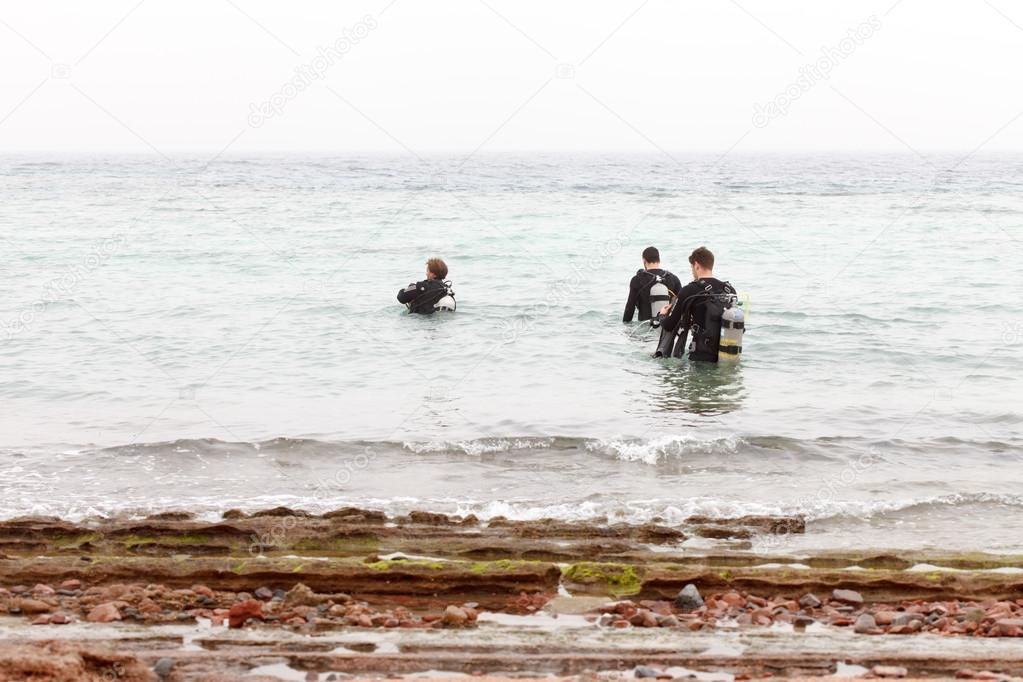 Divers on the beach of Red Sea