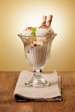 Ice cream in the glass on the table