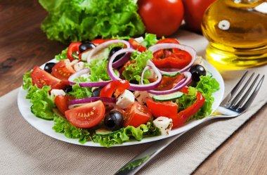 The Greek and Italian food - fresh vegetable salad on the table