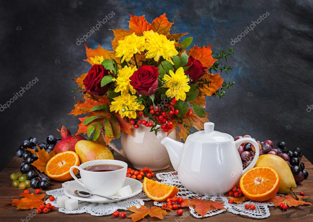 Autumn still life. Tea, flower and yellow leaves