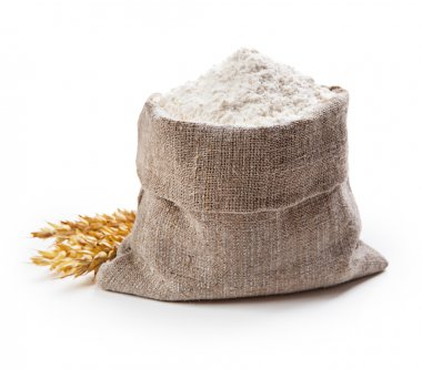 Flour in bag with wheat ears