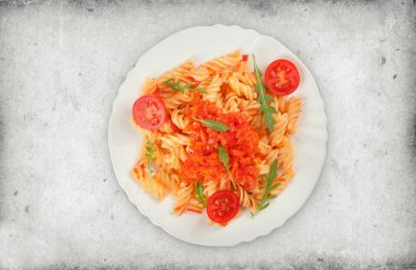 Fusilli pasta with tomato sauce and arugula