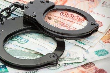Handcuffs on Russian money