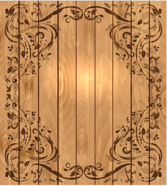 Vintage foliar frame on wooden texture