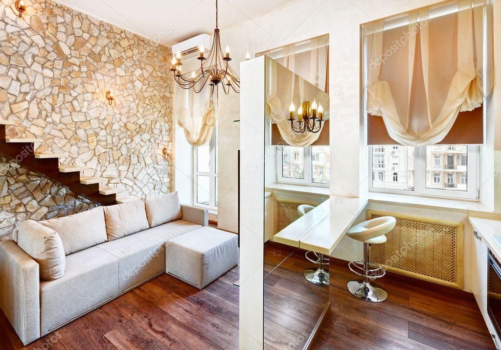 int rieur de salon de style moderne avec mur de pierre de. Black Bedroom Furniture Sets. Home Design Ideas
