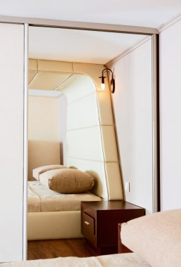 Detail of modern style bedroom interior in beige tones