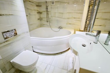 Modern white bathroom interior with jaccusi