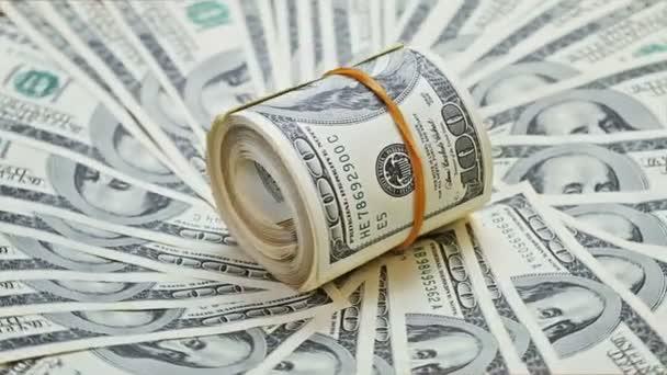 rotující zahrnutý bankovek 100 dolaru na pozadí peníze