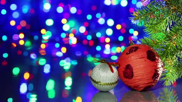 Christmas tree decorations balls with spruce branch on blinking bokeh background