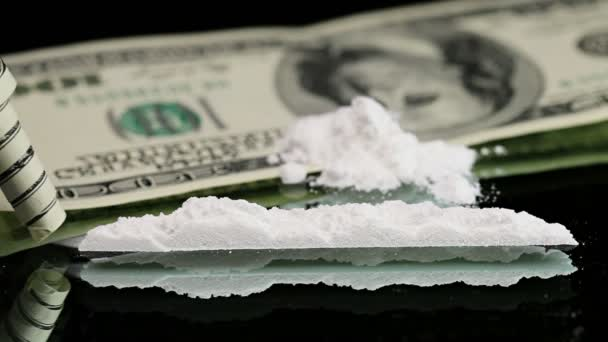 Cocaine snorted on a mirror through rolled 100 dollar bank note