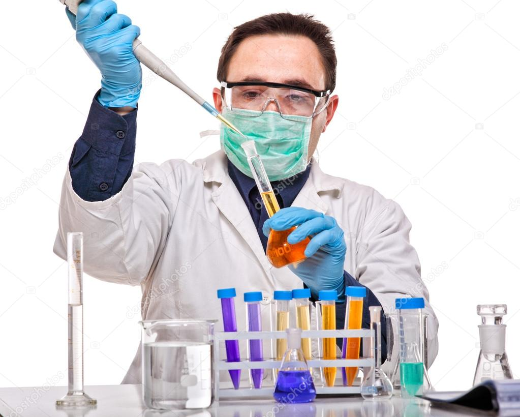 Caucasian young scientist at work on white background
