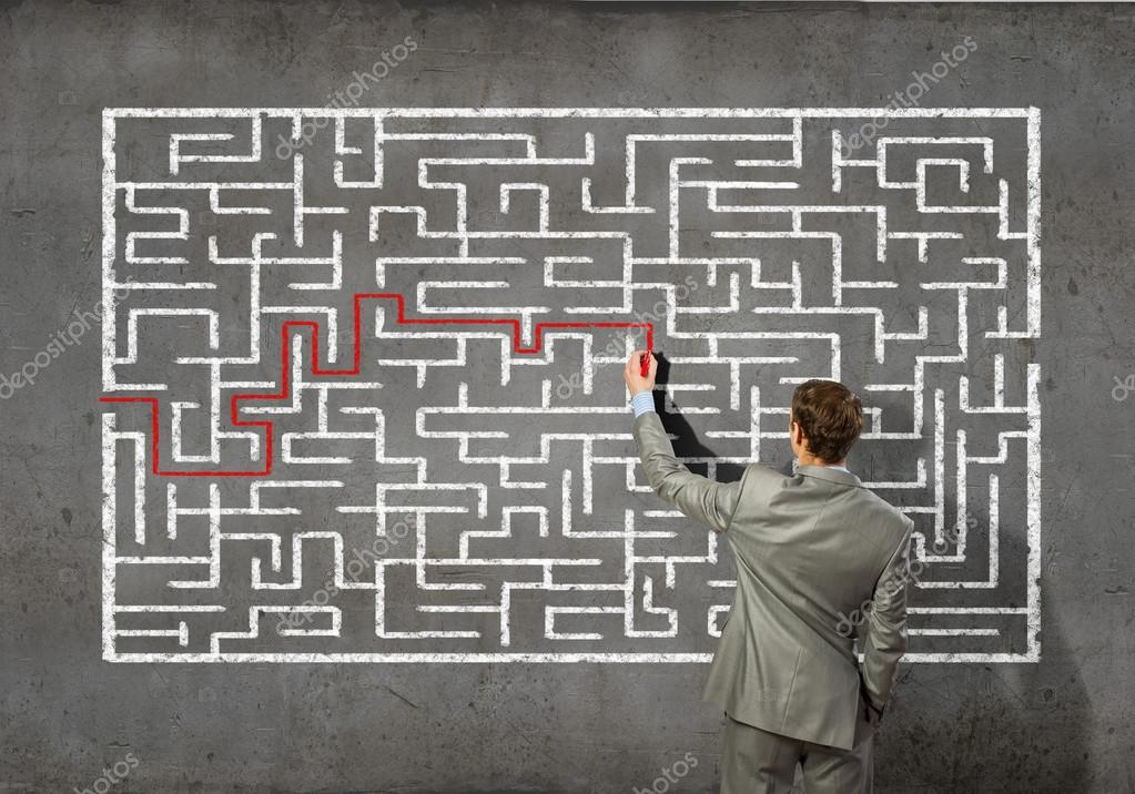 Businessman solving labyrinth problem — Stock Photo © SergeyNivens