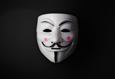Anonymous mask over dark background
