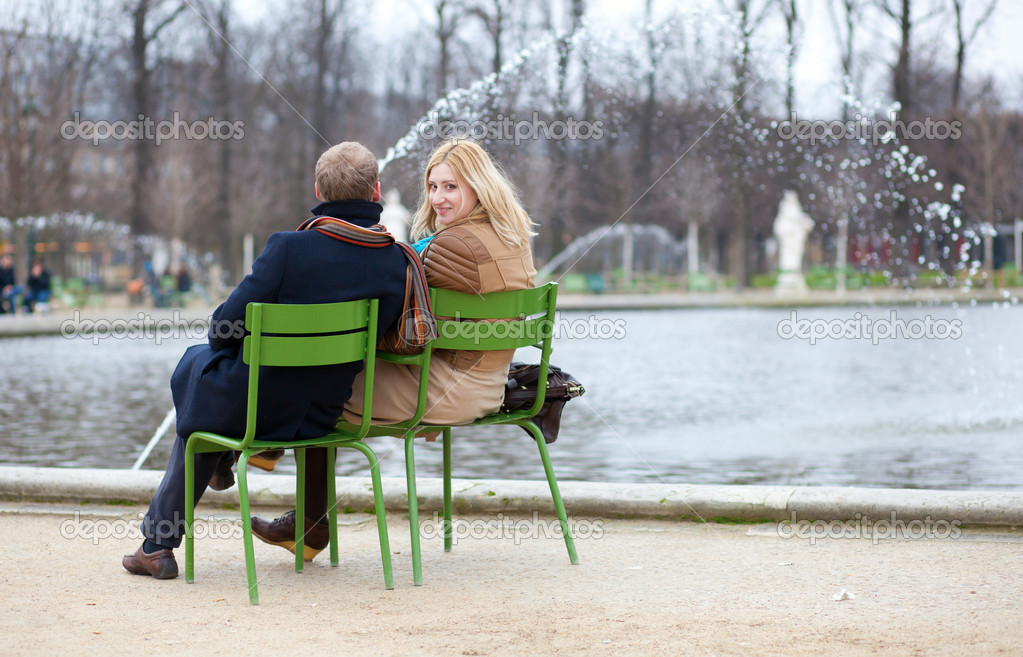 Couple in Paris, sitting in the Tuilleries park
