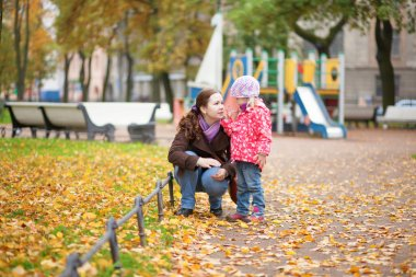 Mother and daughter together at the playground