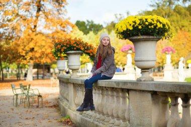 Cheerful girl enjoying a fall day