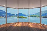 prázdný moderní salonek s velkým arkýřovým oknem