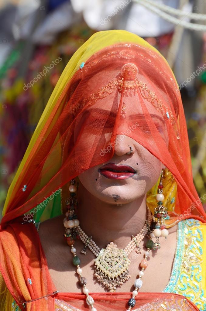 Gay (hijra) dressed as woman at Pushkar camel fair,Rajasthan,India