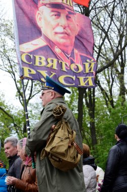 Man hold flag with portrait of Joseph Stalin, Soviet Union leader, during ceremonial parade at Alley of Glory dedicated to 69th Anniversary of victory in Second World War 1941-1945 in Odessa,Ukraine