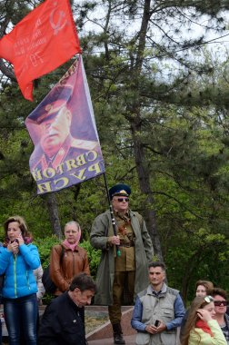 :Man hold flag with portrait of Joseph Stalin, Soviet Union leader, during celebration of Victory Day on May 9,2014 in Odessa,Ukraine
