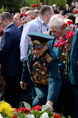 Old soldier come put flowers to Eternal Flame during celebration Victory Day,Odessa,Ukraine