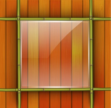 Bamboo frame with glass banner on the wooden background