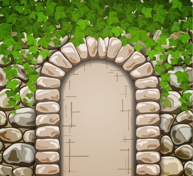 Stone wall with medieval arch and leaves