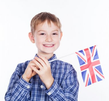 A little boy with english flag on the white background