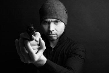 Portrait of a man holding gun