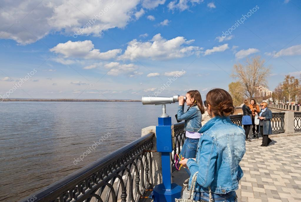 SAMARA, RUSSIA - MAY 1: Girl looks through the coin operated bin