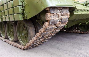 Caterpillars of a military tank close up detail