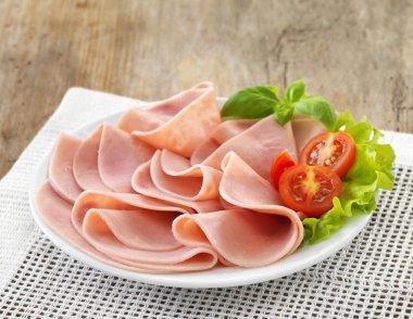plate of sliced pork ham