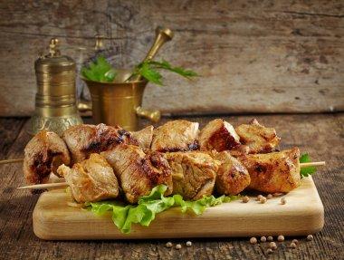 Grilled pork meat kebab on wooden skewers stock vector