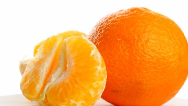 tangerine on white background, rotates