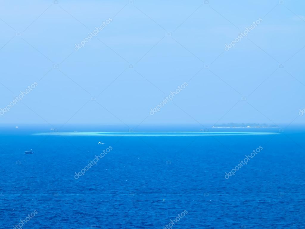 Sparkling turquoise blue water meeting sky