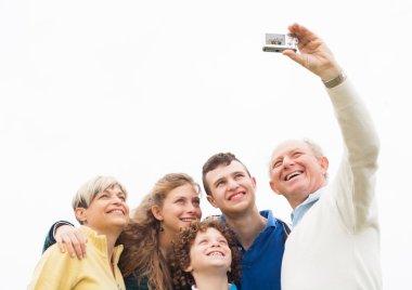 Smiling family taking photos