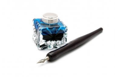 Vintage fountain pen and inkwell isolated on a white background