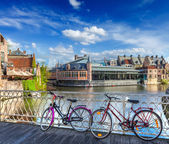 Photo Bridge, bicycles and canal. Ghent, Belghium