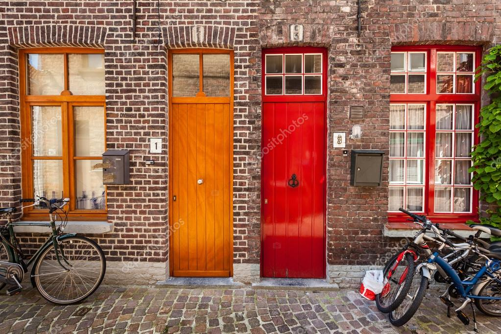 Doors of old houses and bicycles in european city Bruges (Brugge \u2014 Stock Photo & Doors of old houses and bicycles in european city Bruges (Brugge ...