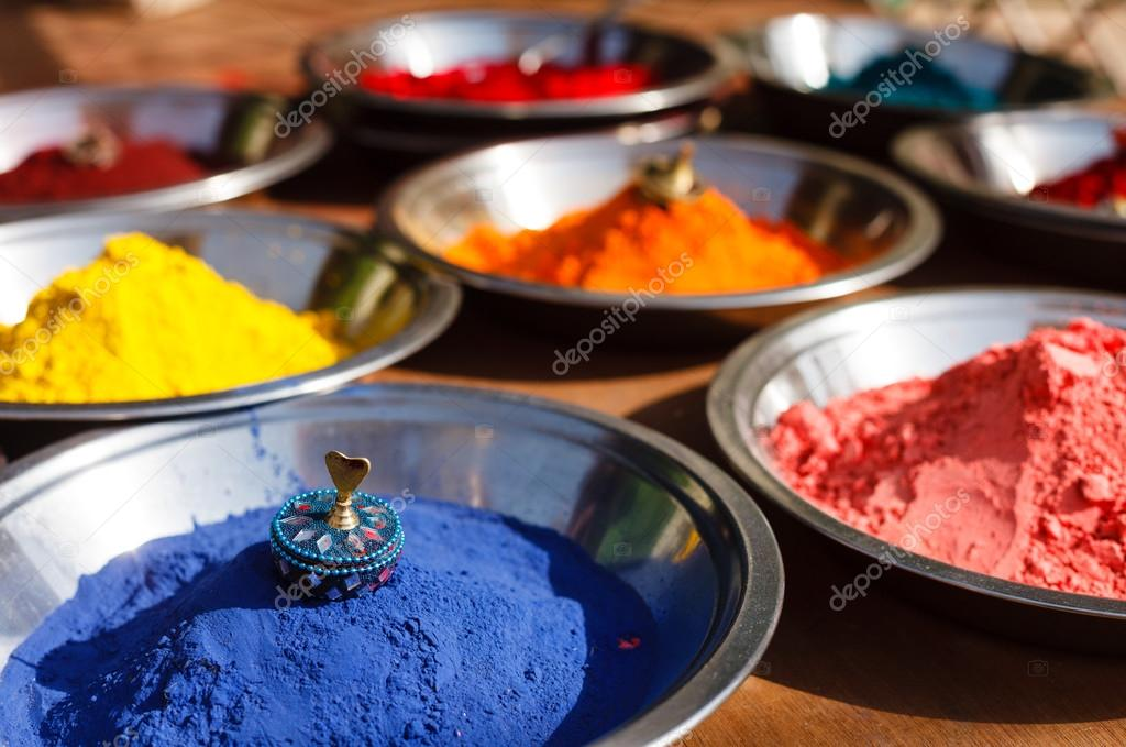 India symbol. Colored colorful powder kumkum in bowls on Indian bazaar for Holi and other festivals celebration stock vector