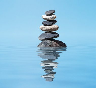 Zen balanced stones stack in lake